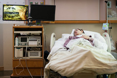 boy in hospital bed photo