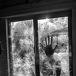 hand at window photo